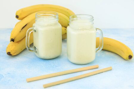 Tasty yogurt or smoothie with banana, vegetarian food, diet and health concept