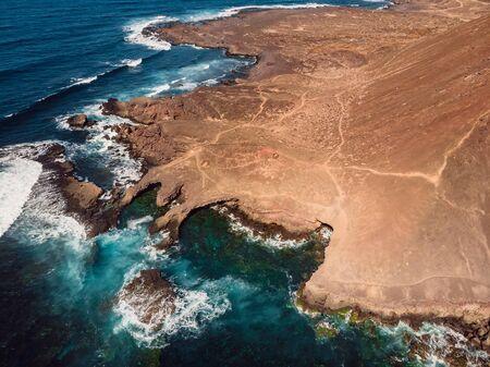 Aerial view of rocky coastline and blue ocean in Lanzarote, Canary Islands. Stock Photo