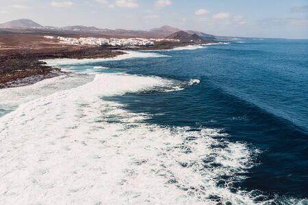Aerial view of La Santa beach with ocean wave and village in Lanzarote, Canary islands