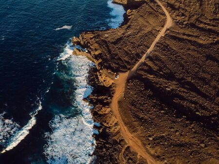 Aerial view of lava cliffs and ocean with sunset tones. Lanzarote, Canary Islands. Stock Photo