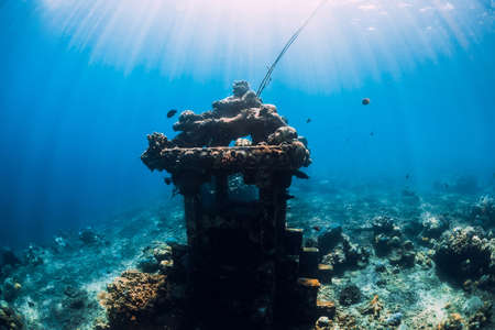 Underwater temple in blue ocean near Amed, Bali. Touristic diving site