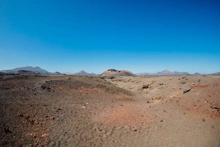 Volcanic landscape with lava, stones and rocks at Lanzarote