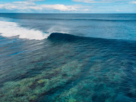Blue surfing wave in tropical ocean at Mauritius. Aerial view of one eye