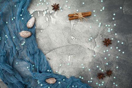Christmas frame made of snowflakes, cinnamon and pine cones on dark. Flat lay. Top view. Winter holiday composition Zdjęcie Seryjne