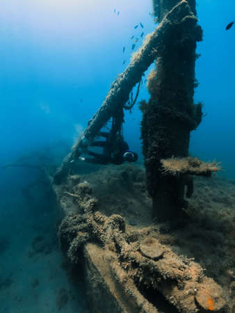 September 10, 2020. Anapa, Russia. Professional freediver in wetsuit and wreck underwater transparent sea.