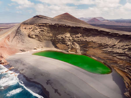 Volcanic crater with a green lake in El Golfo, Lanzarote, Spain. Aerial view