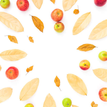 Autumn frame composition. Dried leaves and apple fruits on white background. Flat lay, top view, copy space
