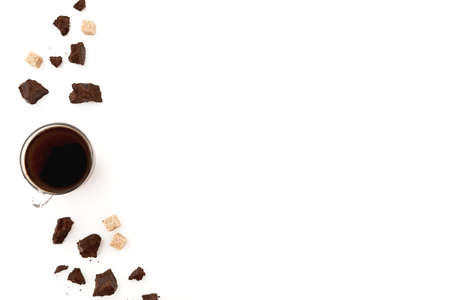 Composition with coffee cup, sugar and pieces of chocolate on white background. Flat lay, top view. Copy space Standard-Bild