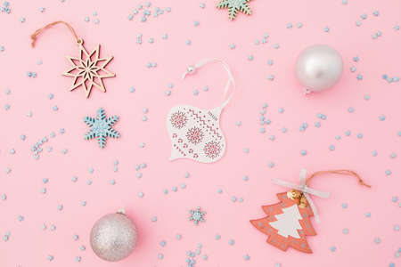 Christmas composition made of silver decoration and confetti on pink background. Flat lay, top view. Stok Fotoğraf