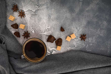 Composition with coffee cup, sugar and chocolate on dark background. Flat lay, top view Stok Fotoğraf
