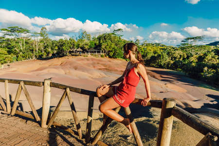 Young woman at Seven Colored Earths in Chamarel National park, Mauritius island