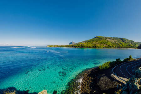 View to Le Morne from Maconde point with ocean and sunlight in Mauritius Island