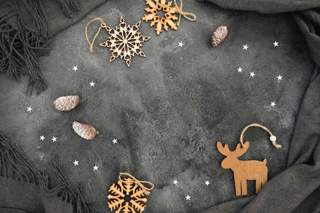 New Year winter frame concept. Christmas wooden decoration with cloth on dark background. Flat lay, top view. Stok Fotoğraf