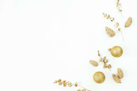 Christmas winter composition. Golden decoration on white background. Flat lay, top view. New Year holiday Stok Fotoğraf