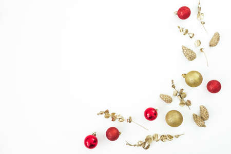 Christmas winter composition. Golden and red decoration on white background. Flat lay, top view. New Year holiday Stok Fotoğraf