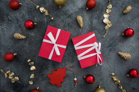 Christmas composition with gifts and golden decoration on dark background. Flat lay, top view Stok Fotoğraf