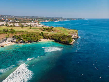 Blue ocean and cliff at background. Aerial view of tropical island with waves Stok Fotoğraf