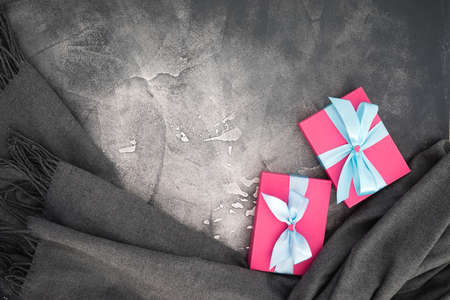 Present composition with gifts on gray background. Flat lay, top view 写真素材
