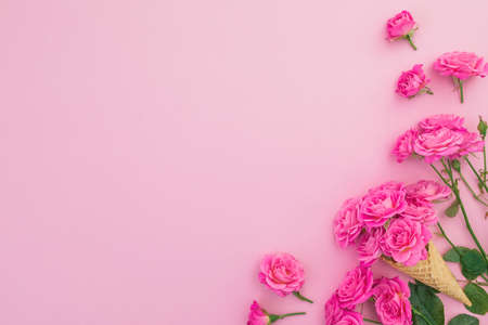 Floral frame of roses flowers isolated on pink background. Flat lay, Top view. Valentines day