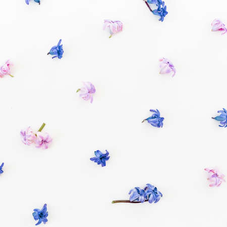 Floral pattern made of petals and flowers on white background. Flat lay, top view