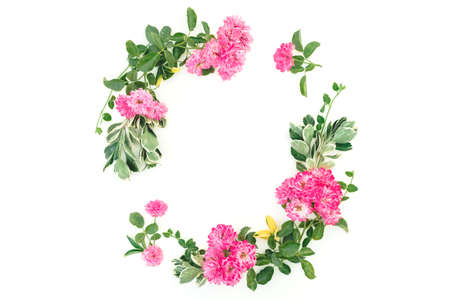 Round frame with pink roses and leaves on white background. Flat lay, Top view