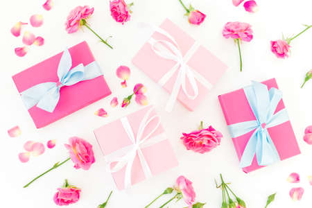 Floral composition of pink roses flowers and gifts on white background. Flat lay, Top view 写真素材