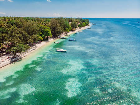 Tropical view with beach and crystal ocean, aerial view. Gili islands, Indonesia