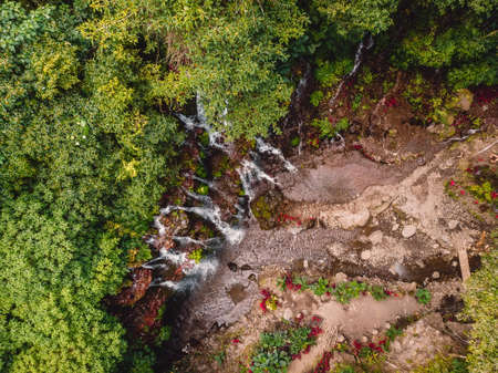 Scenic cascade waterfall in tropical forest. Aerial view