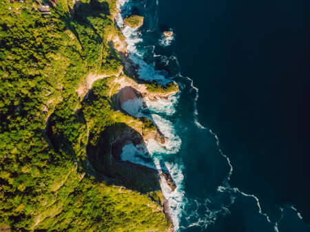 Amazing ocean coastline and blue ocean with waves in Bali. Aerial view 写真素材