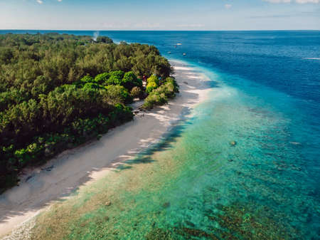 Tropical beach with out people and turquoise ocean at Gili Meno. Aerial drone view. 写真素材