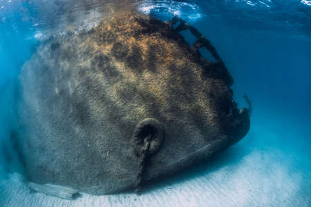 Wreck ship underwater at sand bottom in blue ocean. Arrecife, Lanzarote island