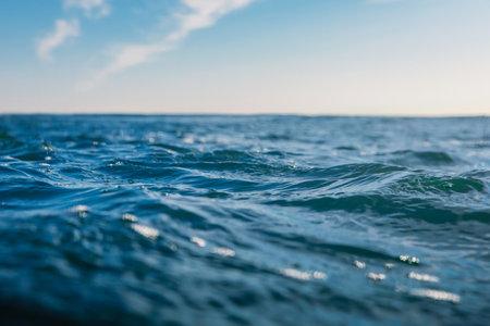 Blue waves in ocean. Water texture with bokeh Zdjęcie Seryjne