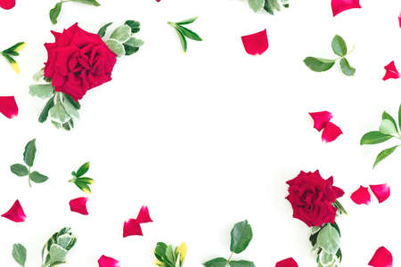 Floral frame made of red roses flowers and green leaves on white background. Flat lay, Top view Zdjęcie Seryjne