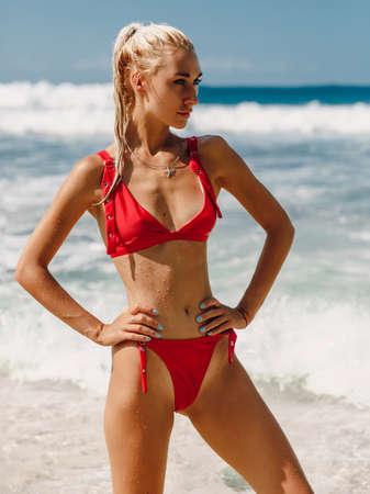 Attractive happy woman in swimwear enjoy summer at ocean beach