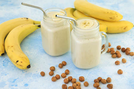 Banana smoothie and nuts. Tasty vegetarian food with banana, diet and healthy concept