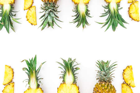 Food frame of juicy pineapple fruits on white. Flat lay, top view. Food concept.