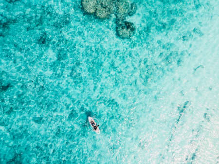 Tourists on holidays and traveling on kayak in transparent ocean. Aerial view