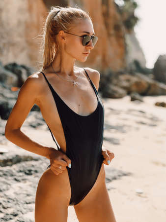 Attractive slim woman in bikini relax at beach in Bali. Caucasian model with ocean Banque d'images
