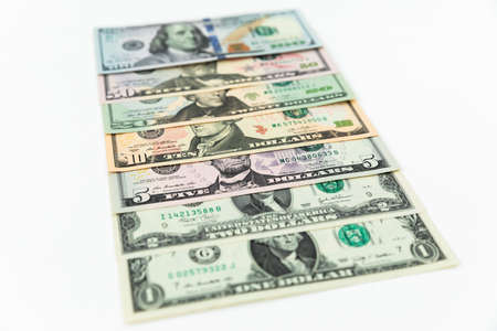 US dollars banknotes. Finance concept of 5, 10, 20, 50 and 100 dollar bills on white background Stock fotó