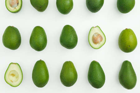Avocado whole and half pattern on white background. Flat lay, top view. Food concept. Stock fotó