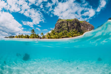 Tropical blue ocean with Le Morne mountain and luxury beach in Mauritius island. Split view. Stock fotó