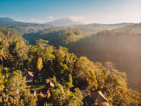 Aerial view of balinese village and mountains in Bali island, Indonesia Stock fotó