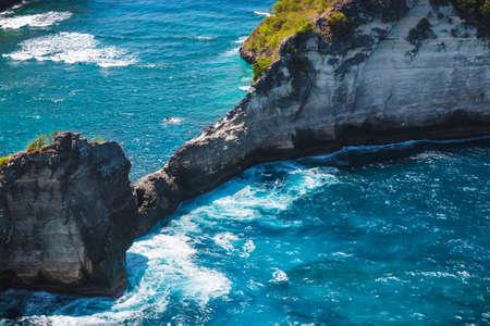 Rocks in blue ocean near Nusa Penida island. Bali, Indonesia.