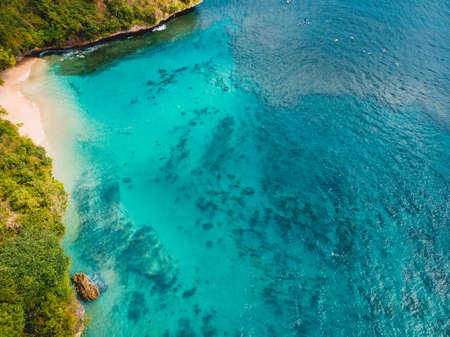 Aerial view of tropical beach with crystal turquoise ocean in Bali