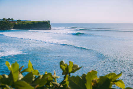 Perfect waves for surfing at Bali. Balangan beach and ocean waves in Indonesia