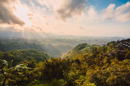 Scenic landscape with mountains, forest and clouds in Bali