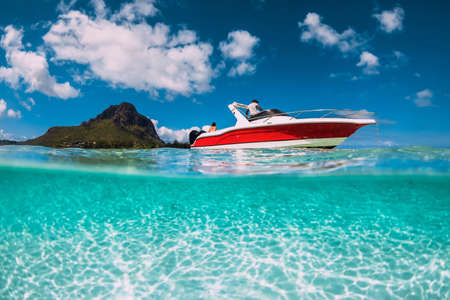 Tropical ocean with sandy bottom and speed boat Stock Photo