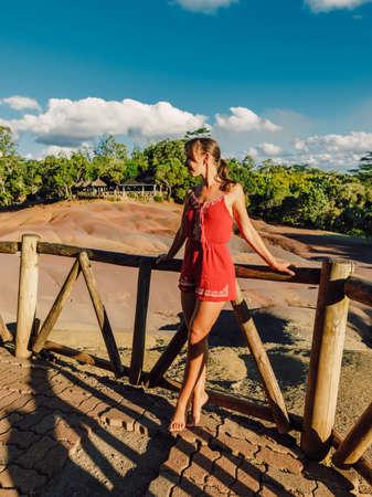 Young woman in bikini at tropical palm beach. Stock Photo