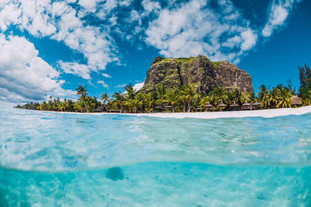 Tropical transparent ocean with Le Morne mountain and beach in Mauritius. Split view.