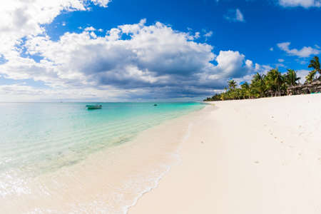 Tropical landscape - luxury beach with blue ocean, mountain and sky of Mauritius island, Le Morne